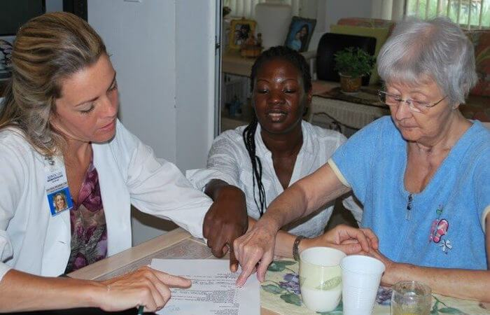 Doctor and caregiver going over results with patient