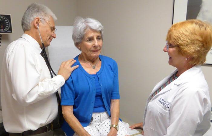 Doctors doing an evaluation of patient