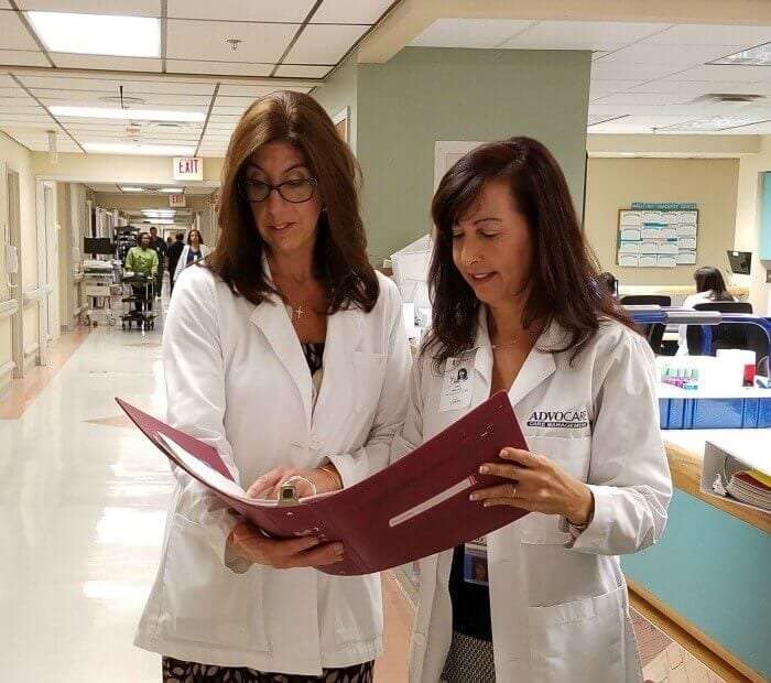 Doctors looking over paperwork inside of hospital