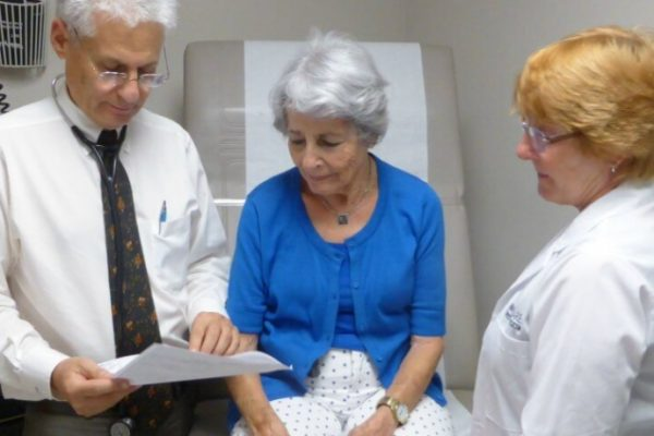 Doctors going over results with patient
