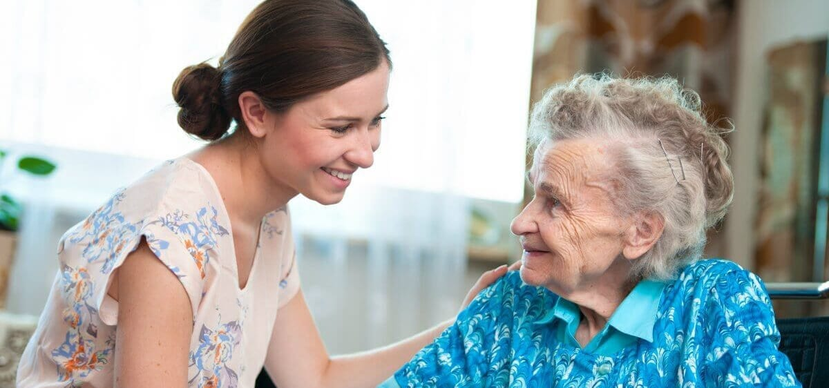 A woman taking care of an older person
