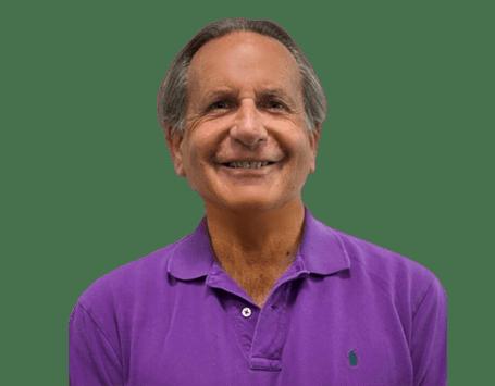 Olden man wearing a purple polo shirt