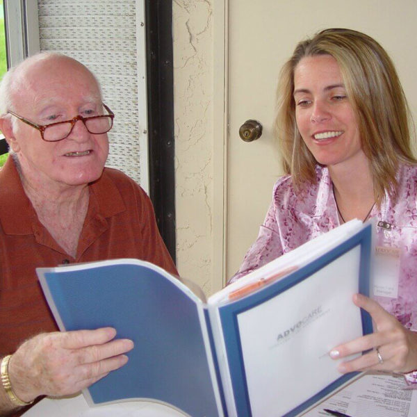 Woman and man reading book together