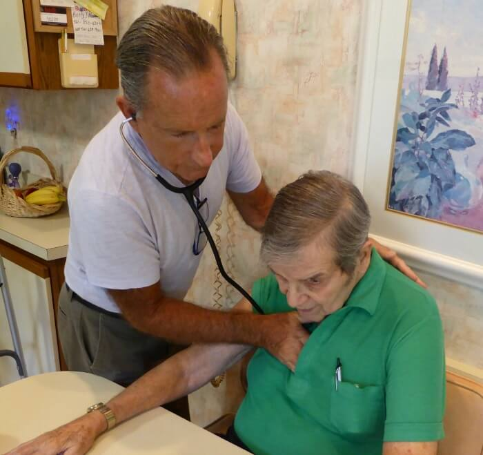 Caregiver taking the heartbeat of patient