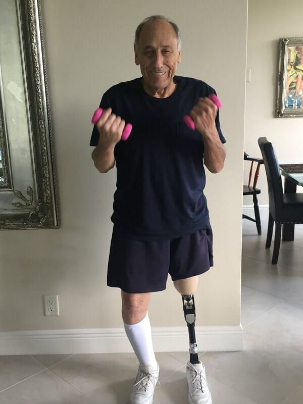 A man with a prosthetic leg lifting weights