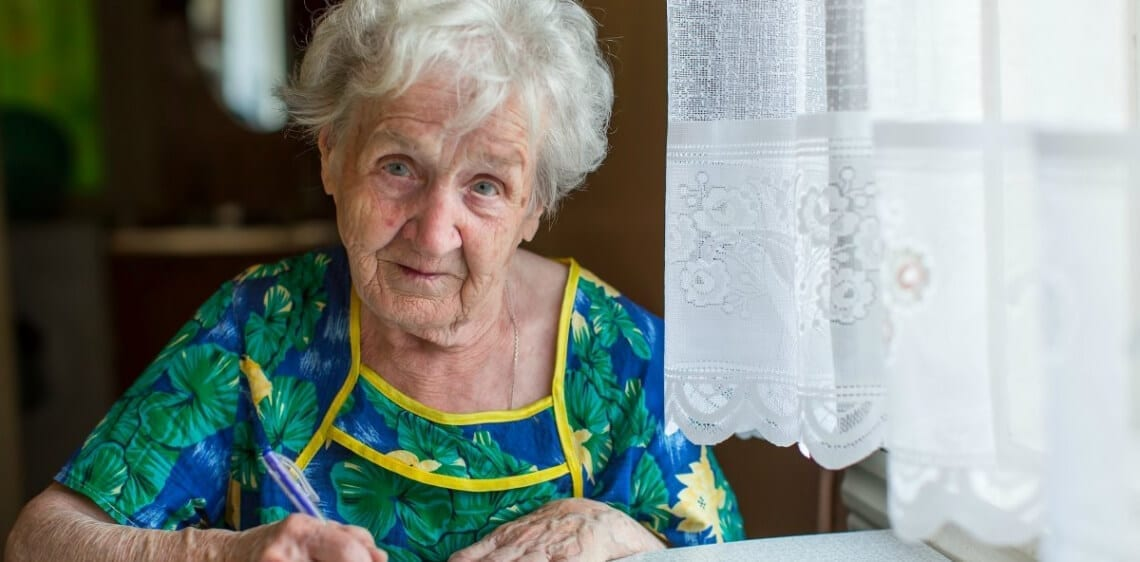 A woman writing something down