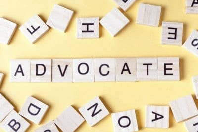 Advocate spelled out in Scrabble letters