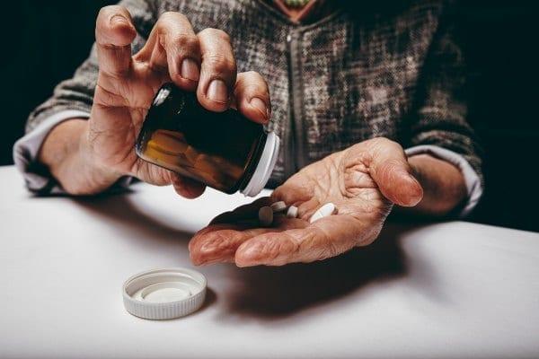 A man taking medication