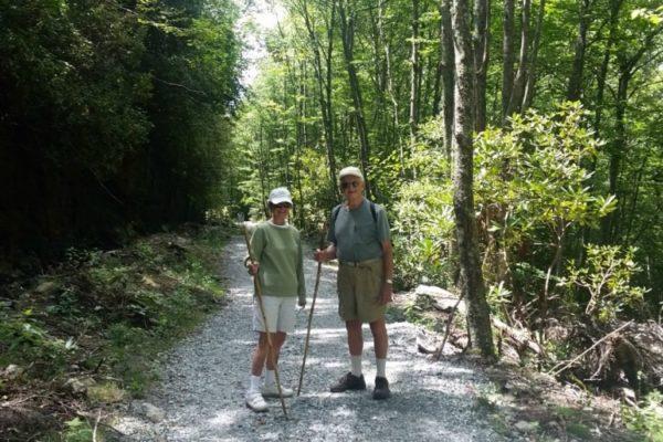 Elderly couple taking a hike