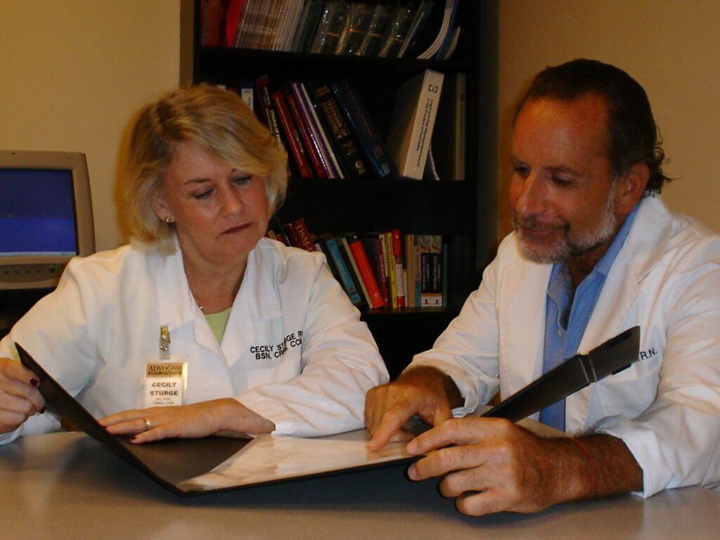 Doctors looking over paperwork