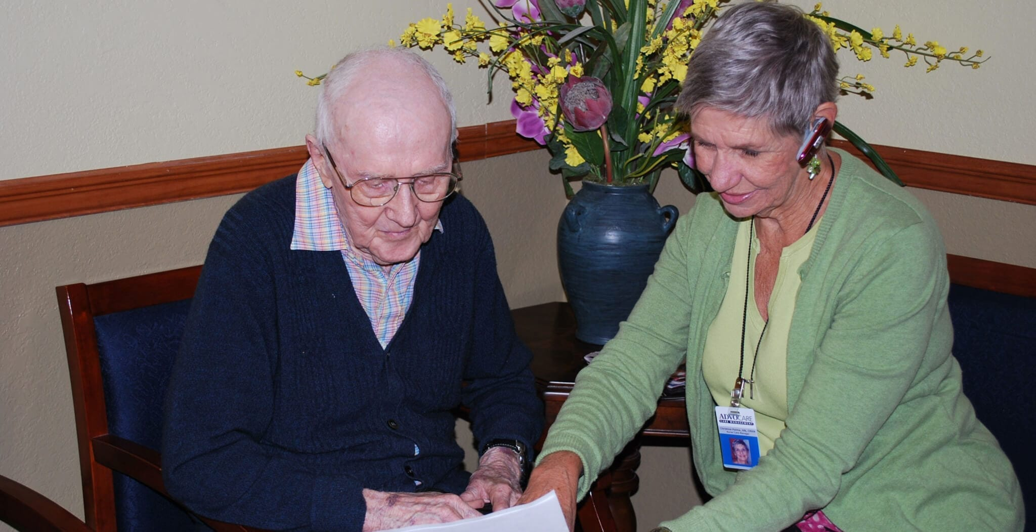 Caregiver reading a document for patient