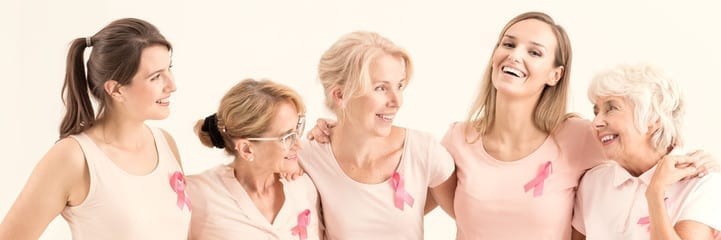 Woman with breast cancer ribbons and pink shirts