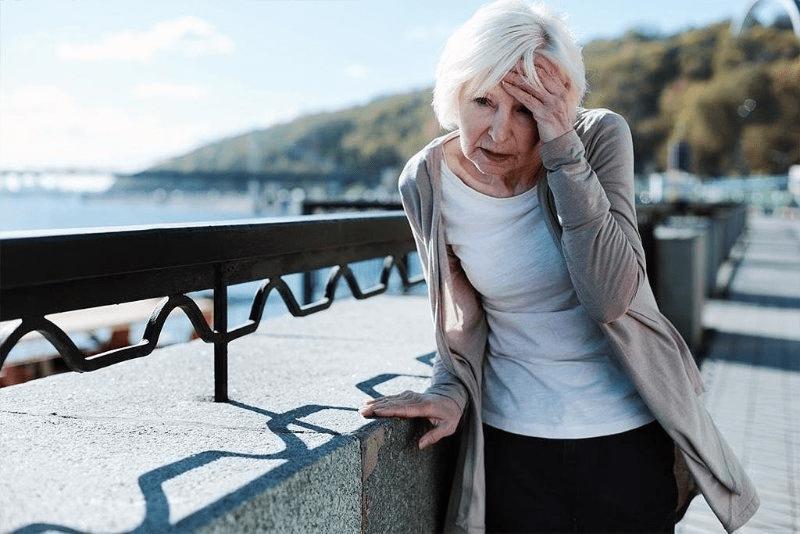 Older woman having a headache