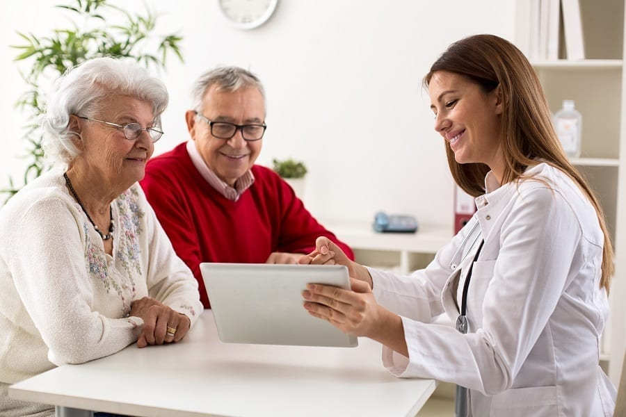 Woman explaining results to elderly couple