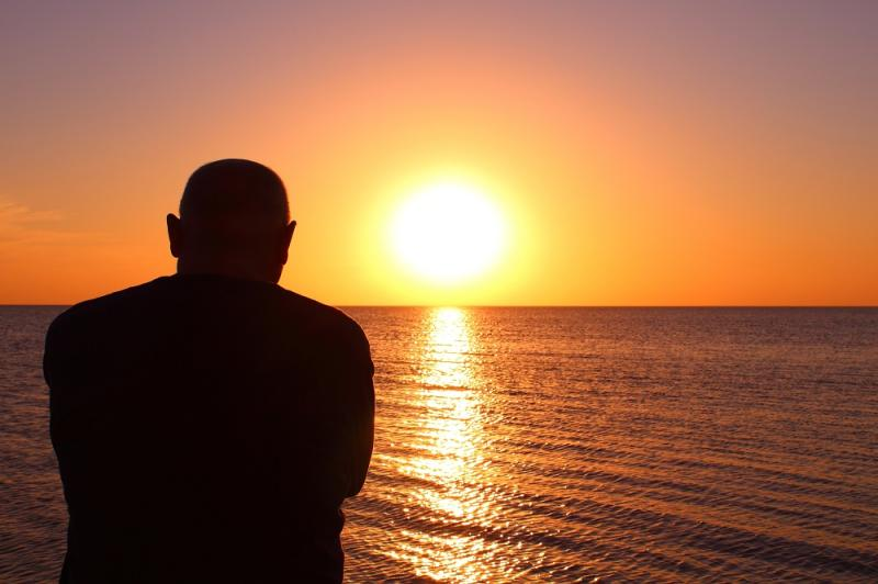 Man looking off into the sunset