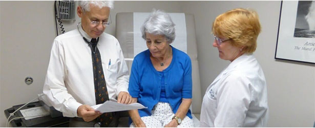 doctors consulting a patient