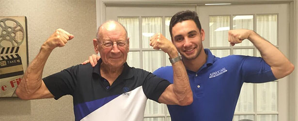 two men showing there biceps